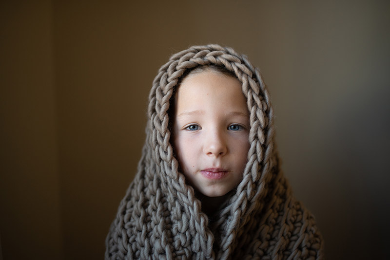 A girl in blanket