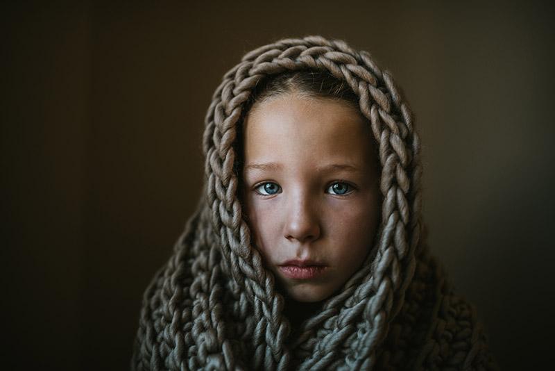 soulful image of girl in blanket