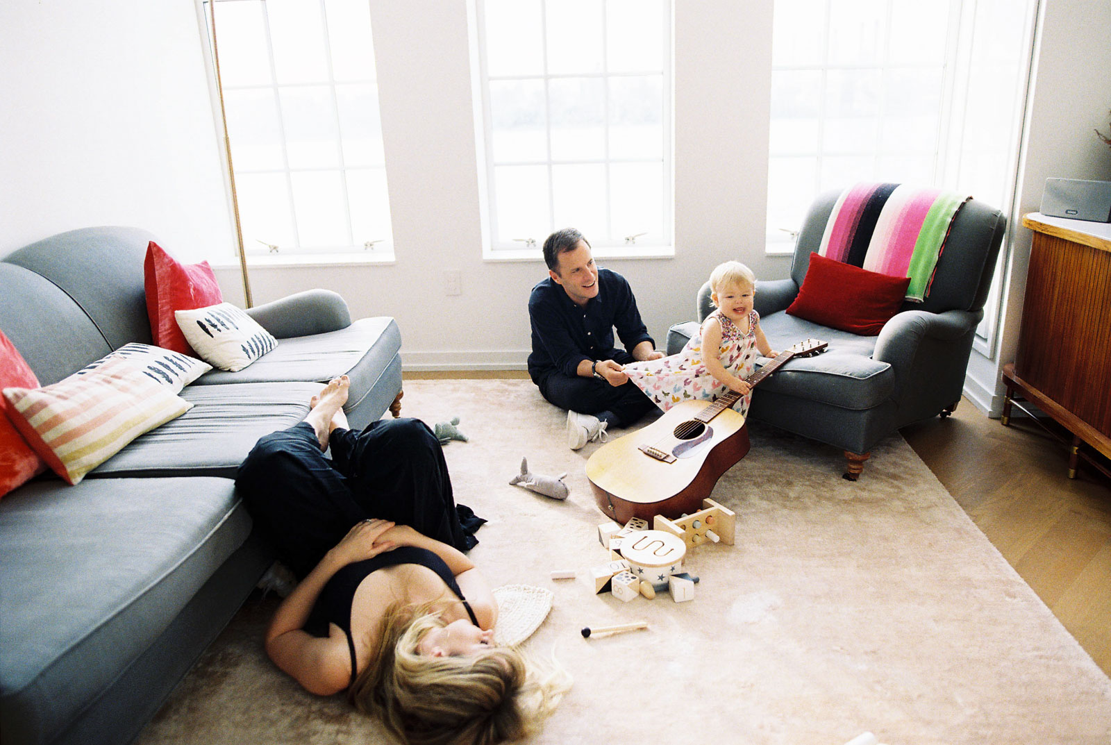 A lifestyle family photo of dream photography clients relaxing