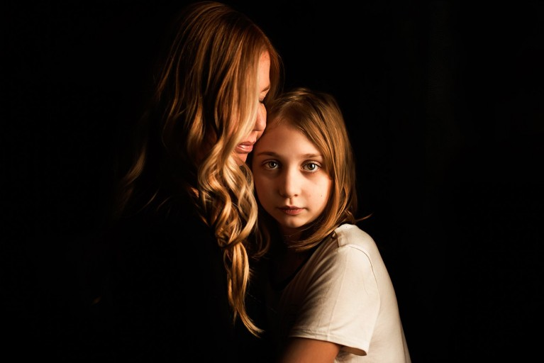 mom and daughter hugging by Melissa Richard