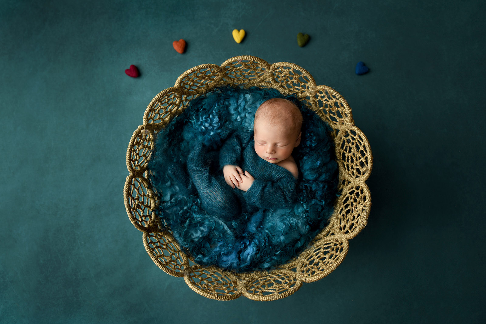 Rainbow baby photos on blue background with hearts