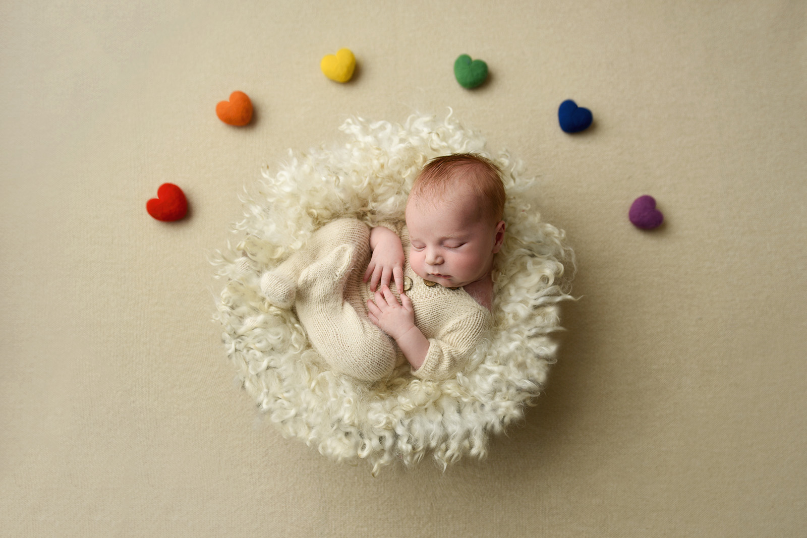 Pictures of rainbow babies, hearts over baby