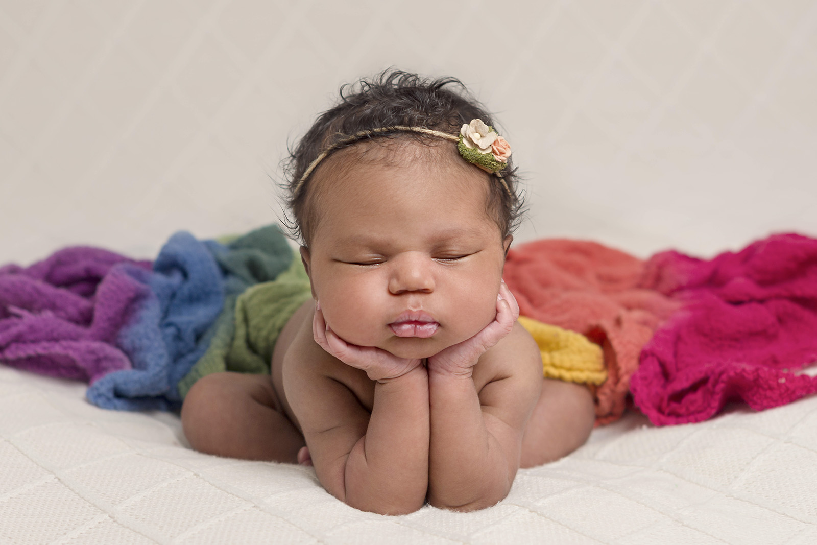 Photo of a rainbow baby in froggy pose