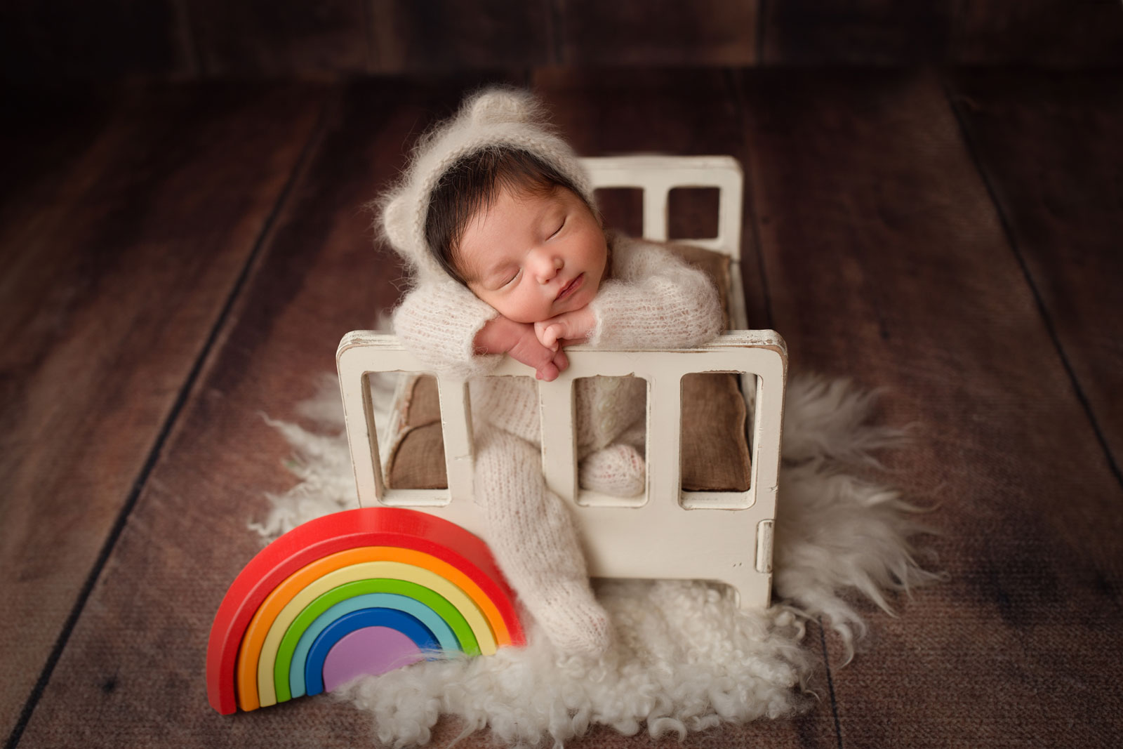 Pictures of rainbow babies with props
