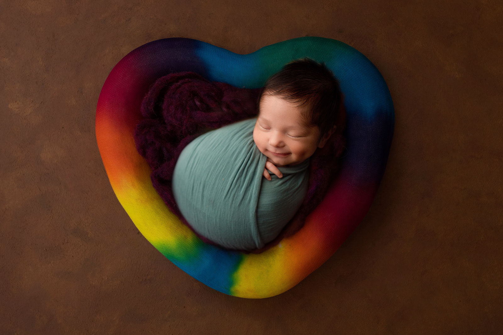 Pictures of rainbow babies in a heart