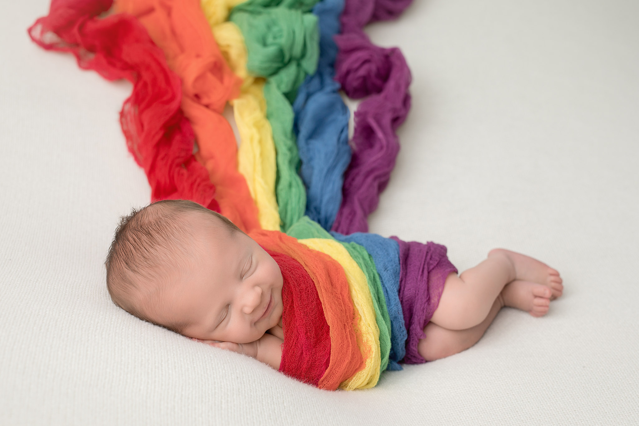 Rainbow baby in primary colors
