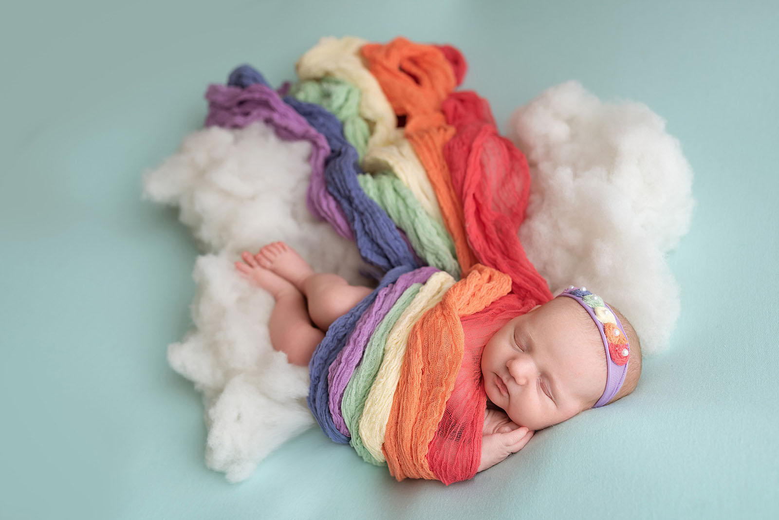 picture of a rainbow baby wrapped in rainbow swaddle