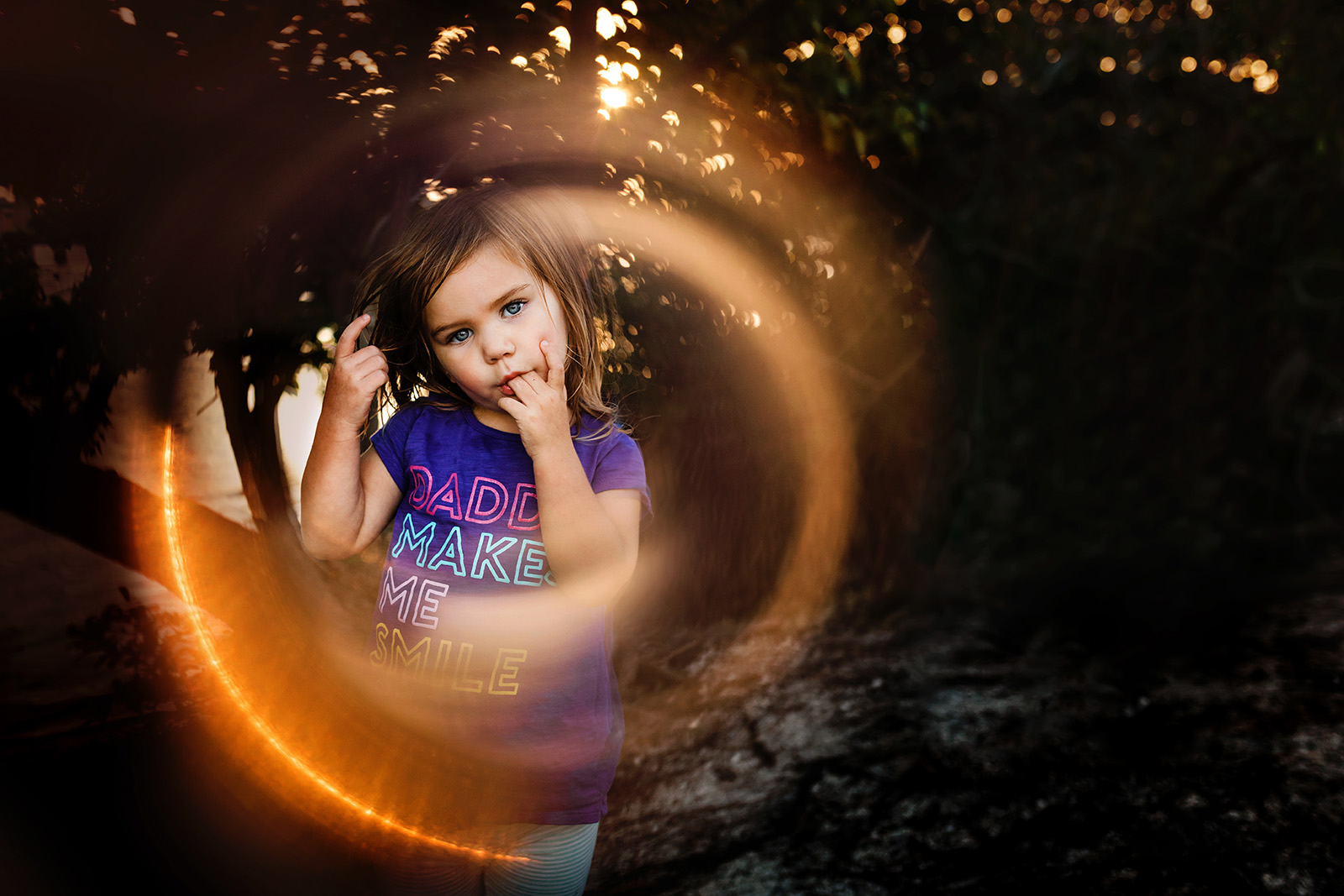 Photo of girl with ring of lens flare