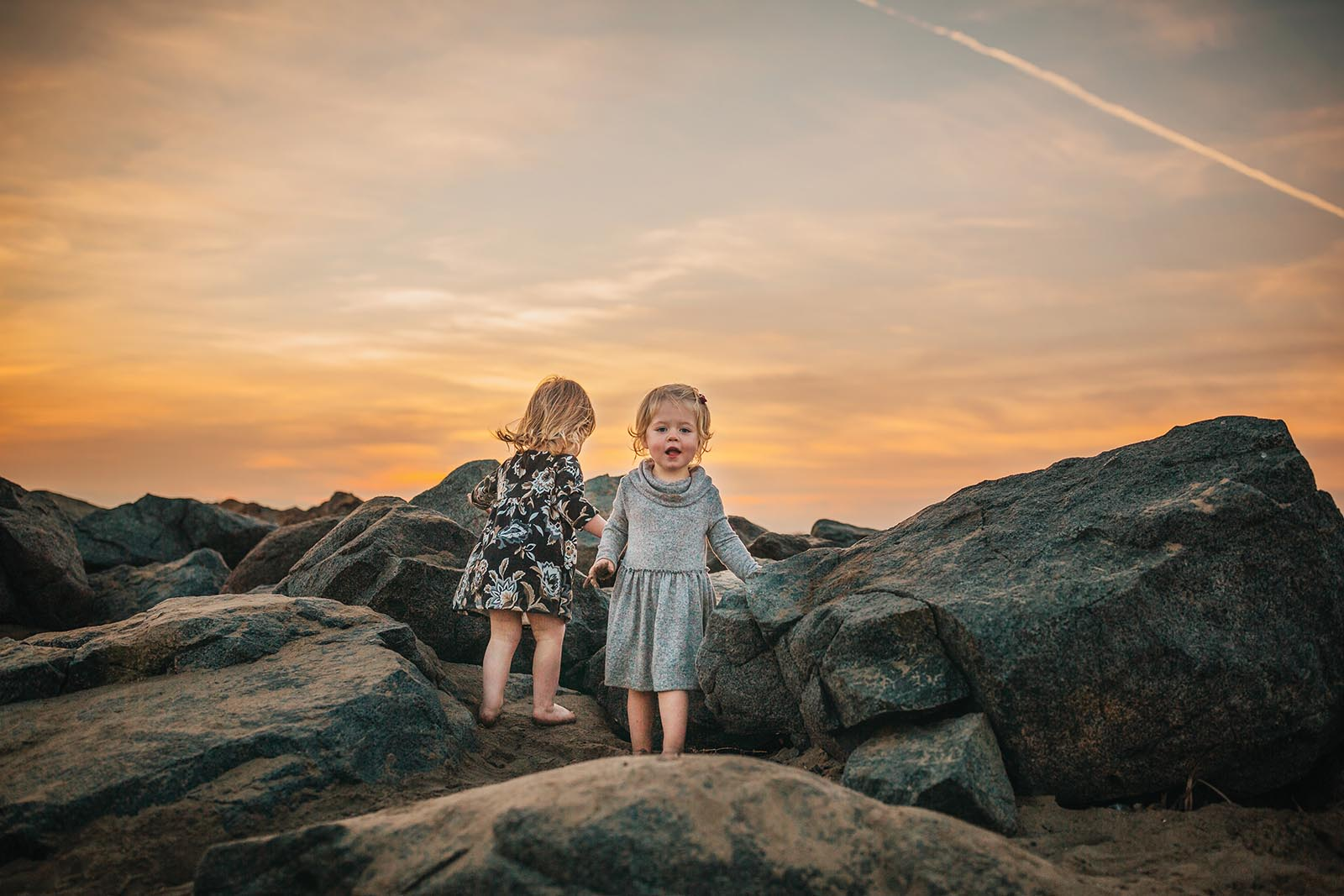 toddlers on rocks at blue hour