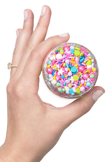 Hand holding sprinkles, client gifts