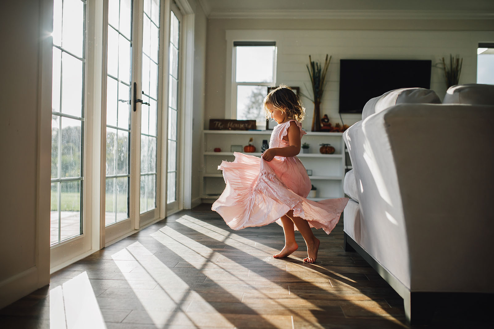 Creative use of window light, little girl twirling