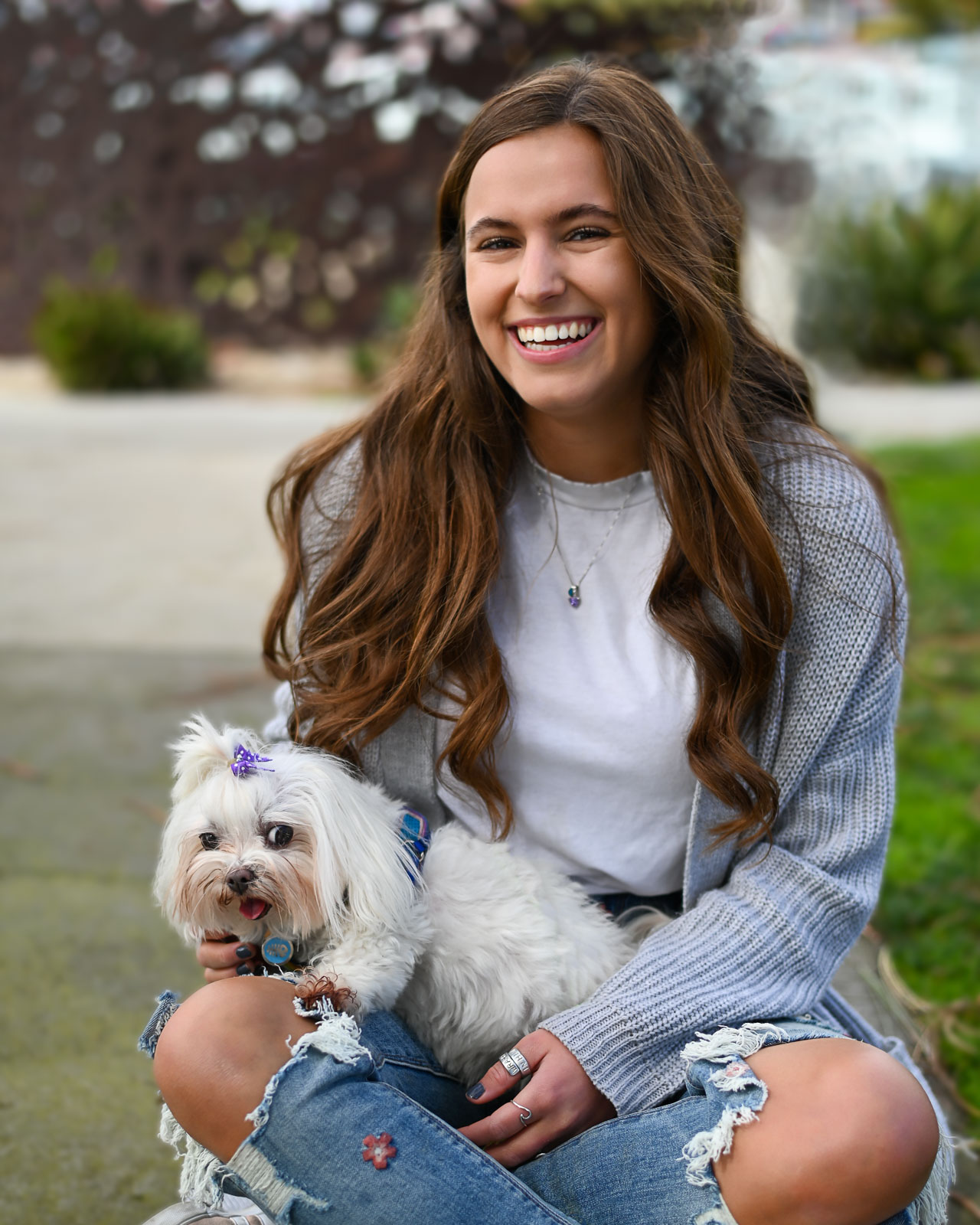 Senior photo of a teen girl and her dog