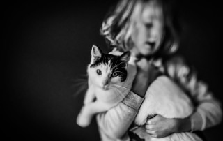 girl holding a cat, taken with a tilt-shift lens, photography on a budget