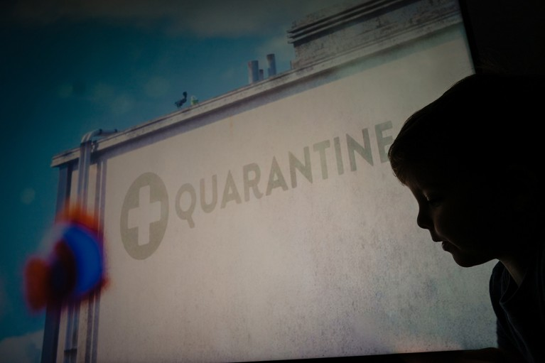 Silhouette of boy in front of quarantine sign during family documentary photo session