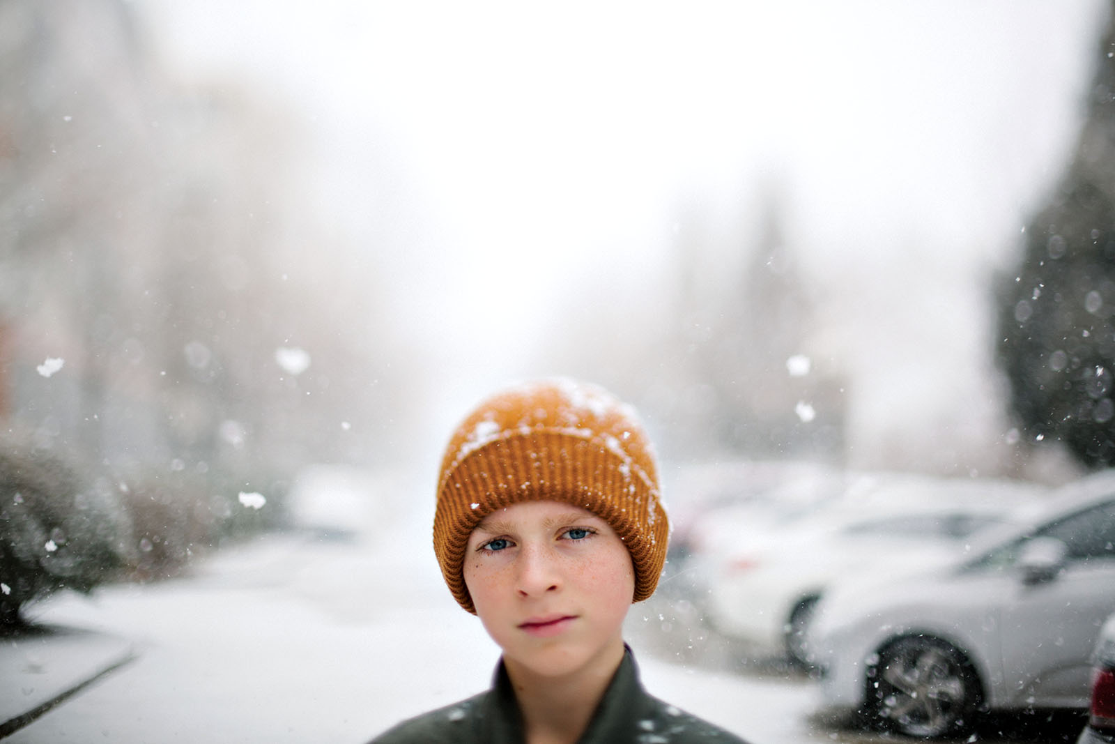 Boy stands in snowy street in China while quarantined