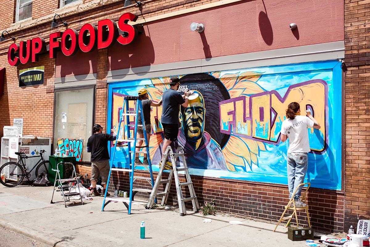 People paint mural of George Floyd at Cup Foods in Minneapolis