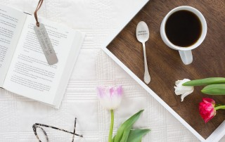 Flat-lay image of coffee and a book