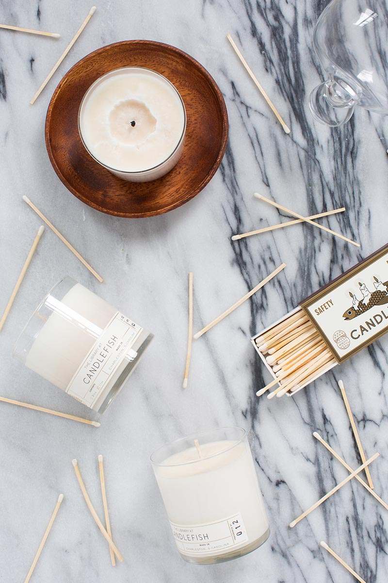 dynamic flat-lay photo of candle and matches