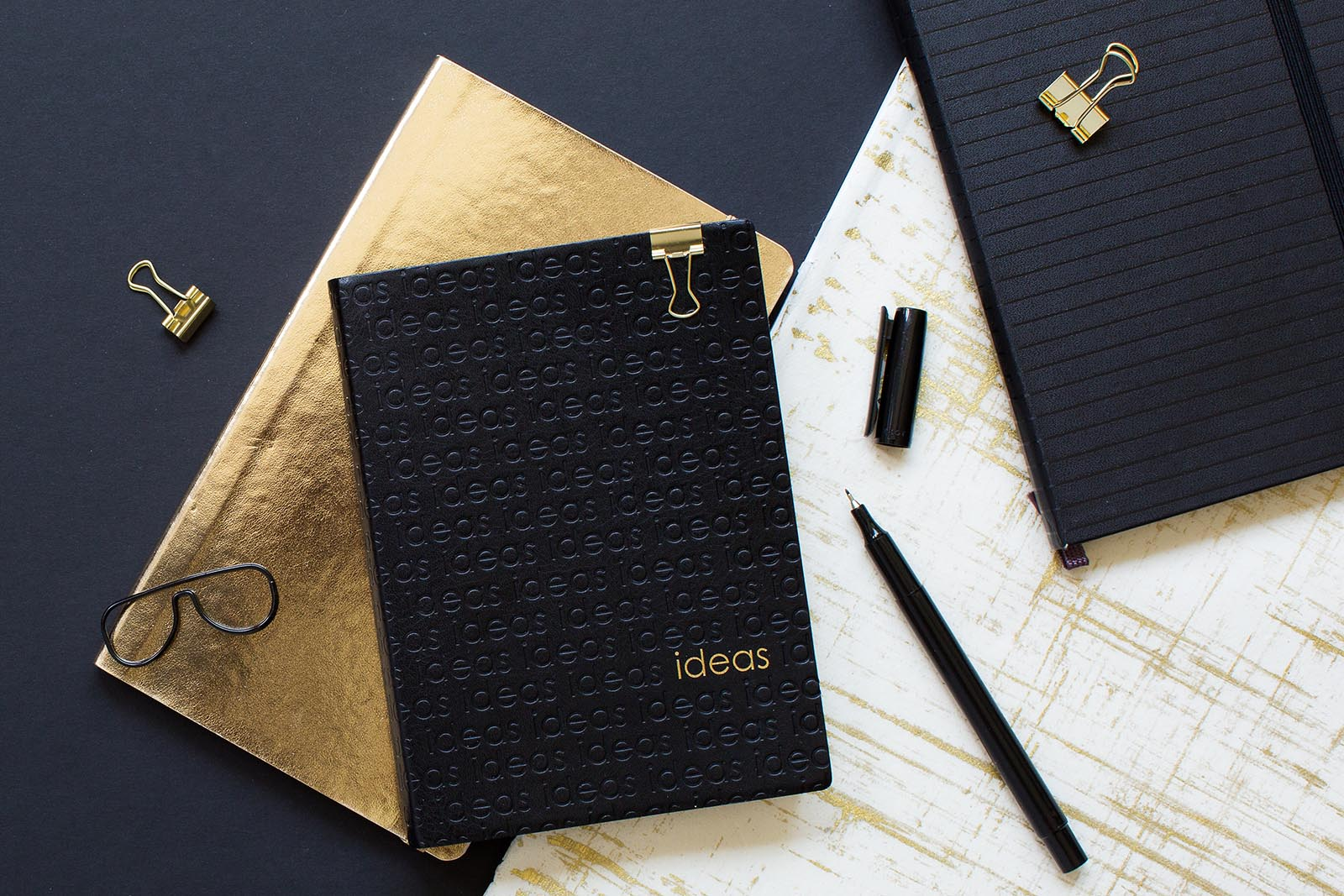 dynamic flat-lay photo of journal