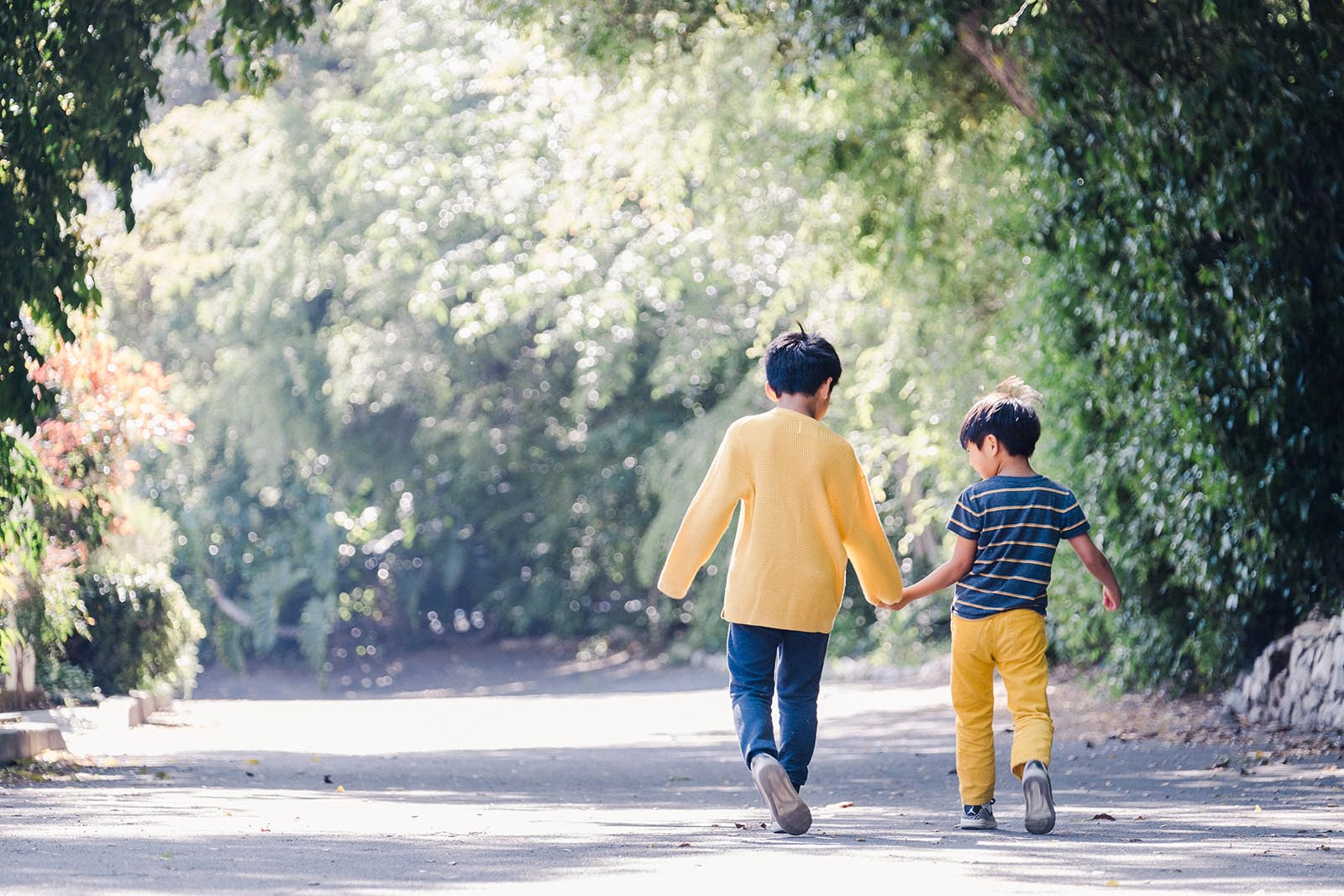 Photo of two boys walking Fujinon XF50-140mm all-purpose zoom lens