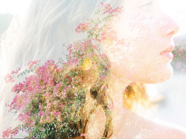 Creative double exposure of girl's hair and flowers