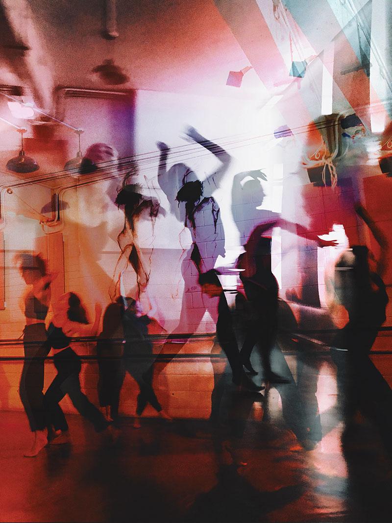Creative double exposure of people dancing
