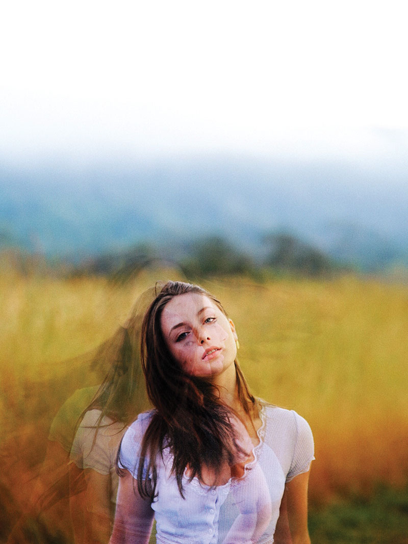 Creative photograph of girl in a field