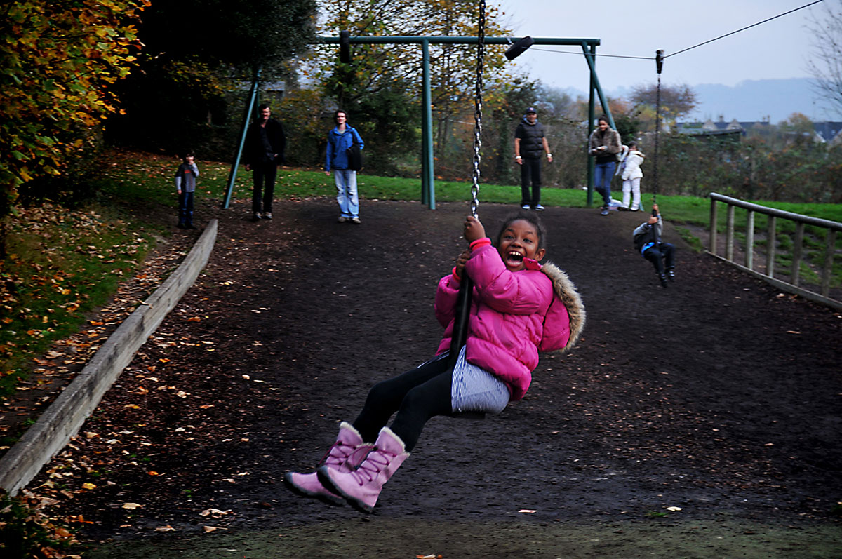 Girl playing on playground zip line