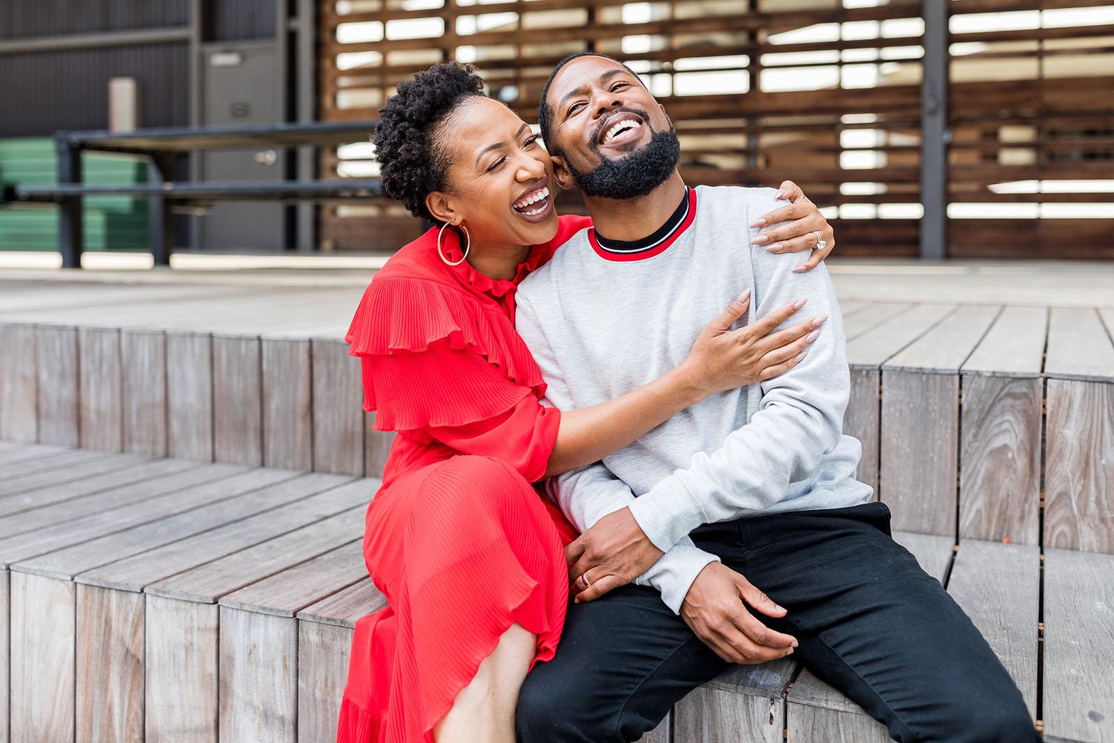 A couple laughs on city steps