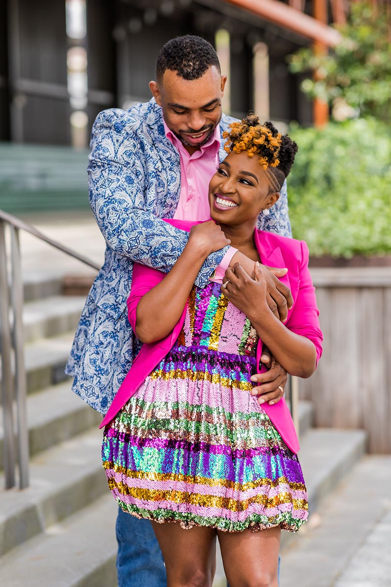 A couple photo of man and woman laughing in bright clothing