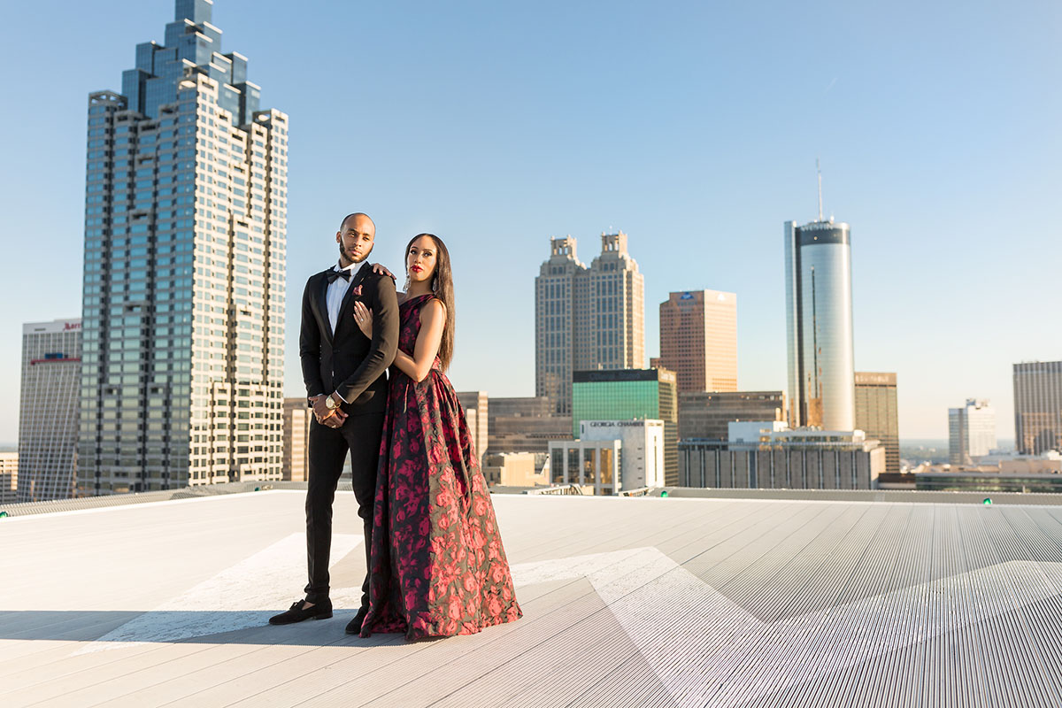 A couple photo on a rooftop by Mecca Gamble