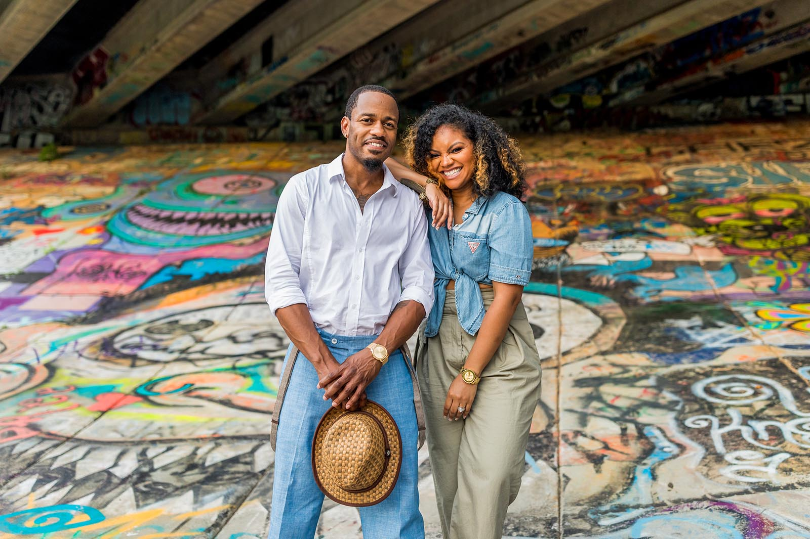 Couples photo on painted mural by Mecca Gamble