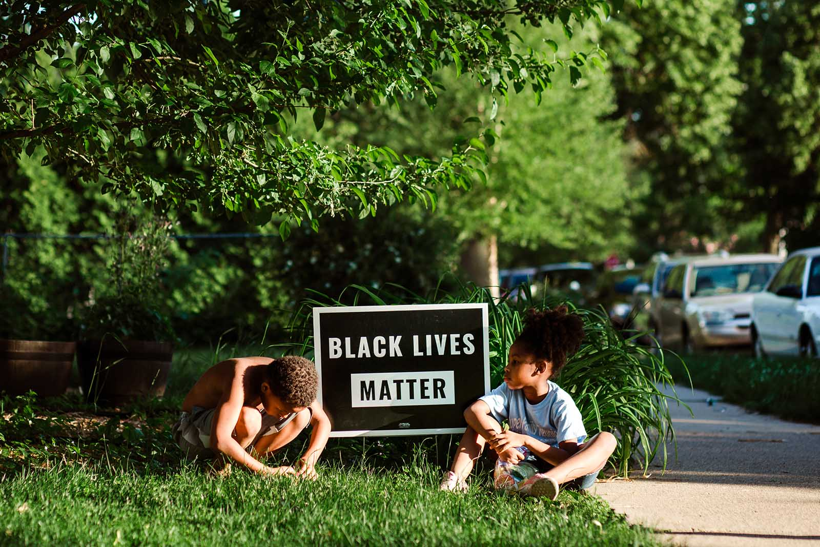 Children outside with a Black Lives Matter sign in Minnesota