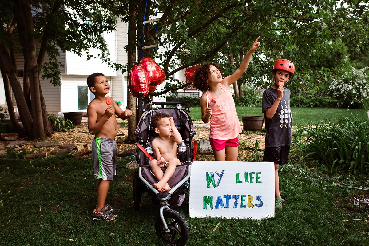 """Children outside with """"my life matters"""" poster during George Floyd protests"""