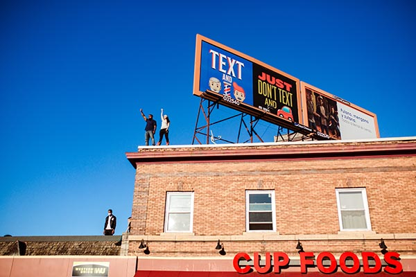 Protesters stand on roof of Cup Foods in Minneapolis during George Floyd protests
