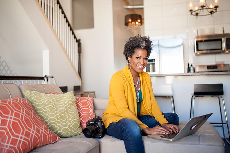 Lifestyle business photo of woman at home on computer