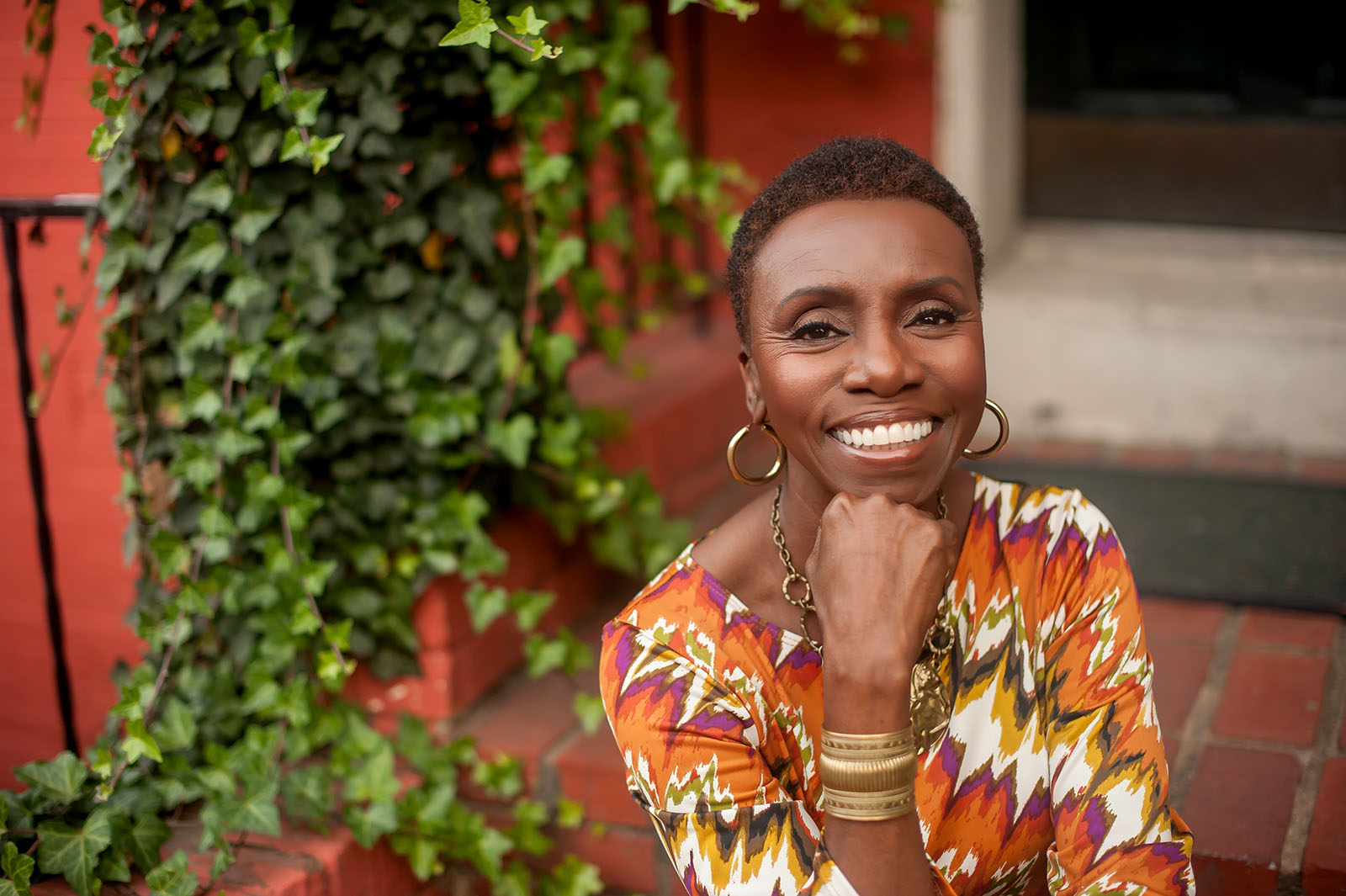 Lifestyle business portrait of Black woman at her front door
