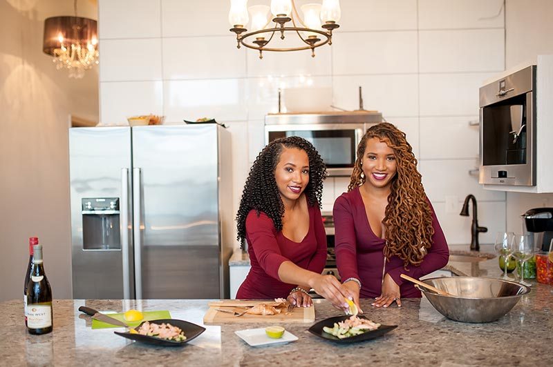 Business portrait of two women cooking in a kitchen
