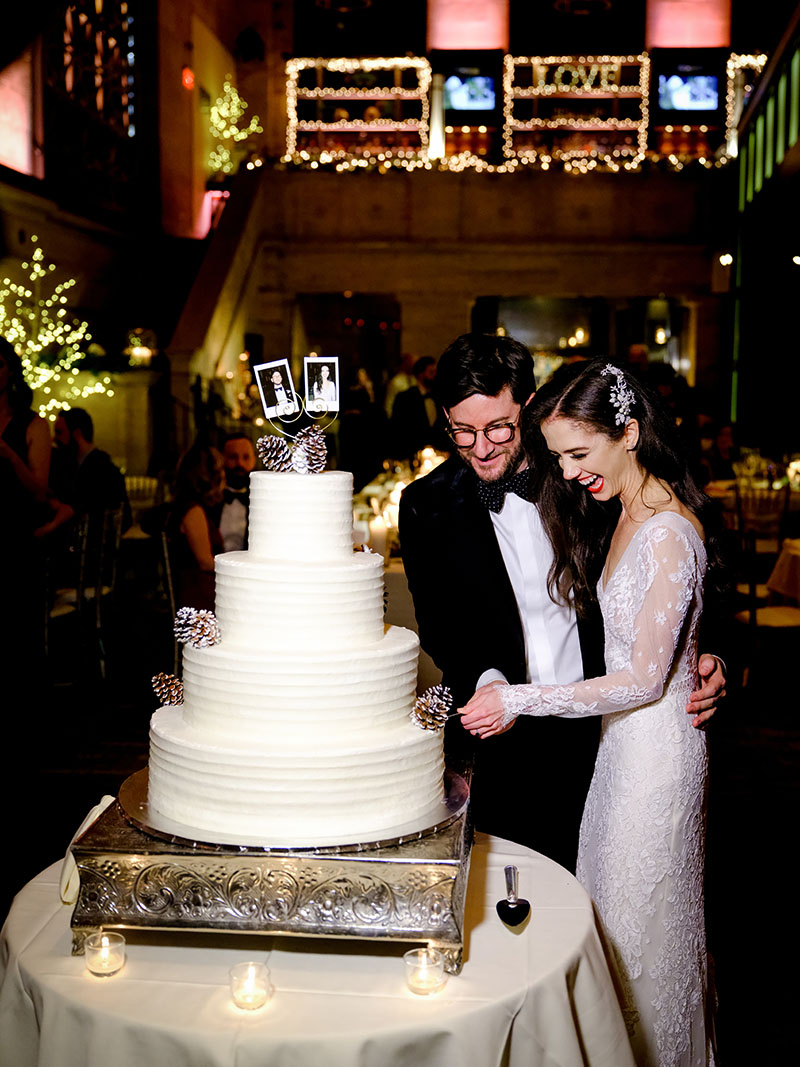 Couple cuts wedding cake, photo taken with Fujinon GF45-100mm f/4 R LM OIS WR lens