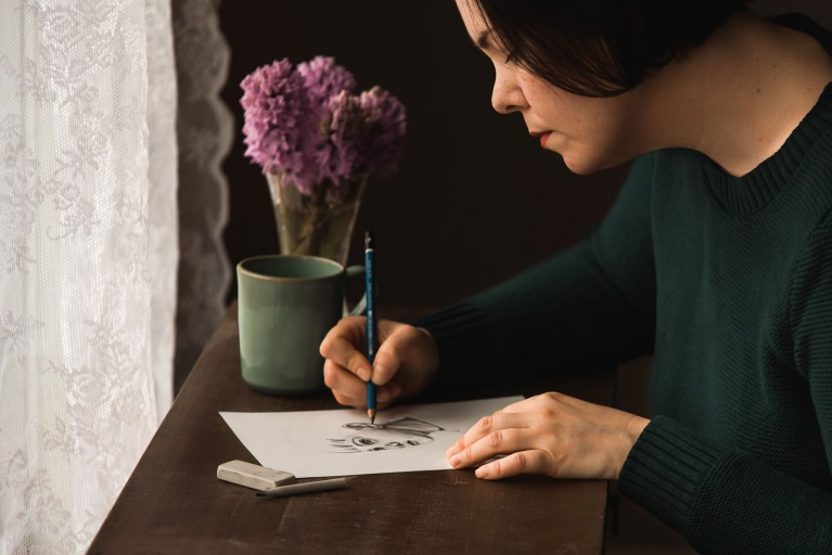 Photo of a female artist drawing