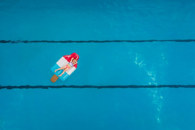 Photo of girl on floatie in pool from above
