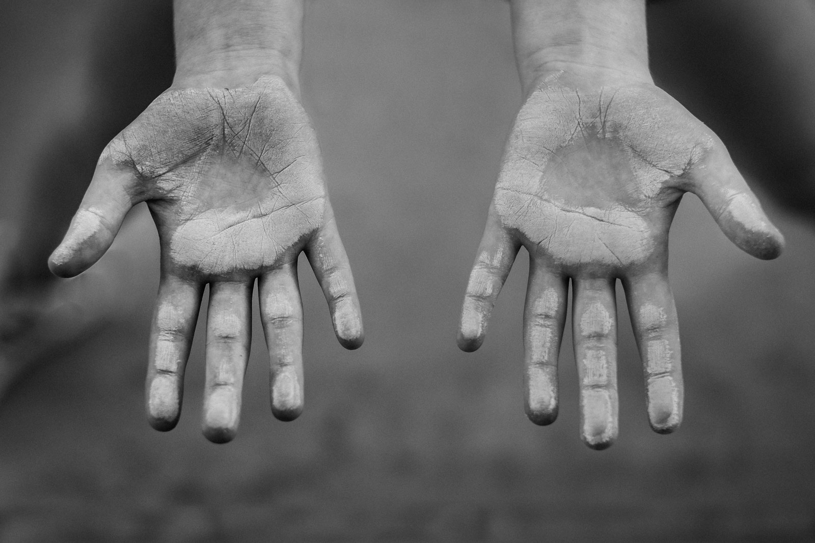 Summer black and white photo of a child's hands covered in chalk