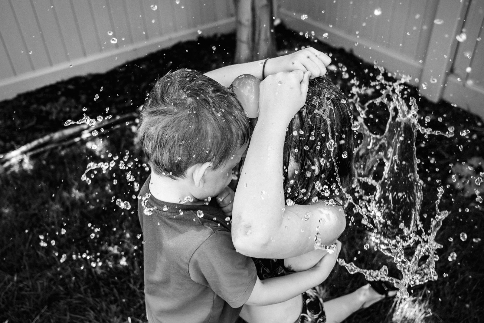 Black and white photo of kids playing in water