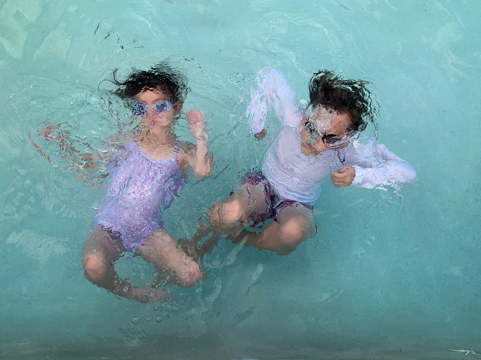 Kids underwater in a swimming pool, taken with iPhone